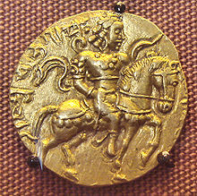 An 8 gm gold coin featuring Chandragupta II